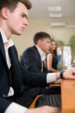 Young business people sitting at a table Royalty Free Stock Image