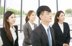 Young business people sitting together Royalty Free Stock Photo