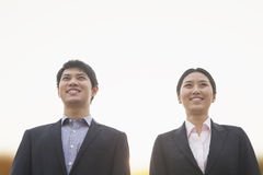 Young business people smiling Royalty Free Stock Image
