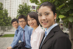 Young business people smiling and looking at the camera, portrait Stock Photos