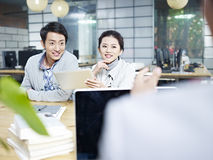 Young business people talking in office Stock Photography
