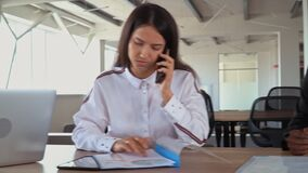 Young business people talking by phone