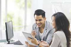 Young business people at their office working together Royalty Free Stock Images