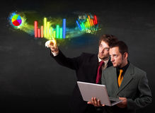Young business people touching colorful modern graph system conc Stock Photography