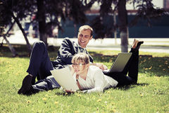 Young business people using laptop in a city park Royalty Free Stock Photo