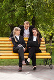 Young business people using laptop in a city park Stock Image