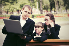 Young business people using laptop in city park Royalty Free Stock Photography
