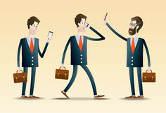 Young Business People using Smartphone Royalty Free Stock Images