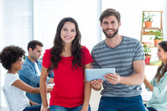 Young business people using a tablet Stock Photos