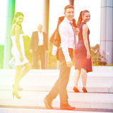Young business people walking up stairs Stock Photo