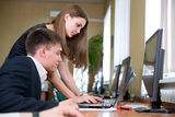 Young business people work in a computer class Royalty Free Stock Photos