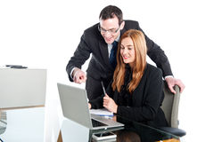 Young business people working on laptop Royalty Free Stock Image