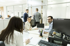 Young business people working at office. Group of young business people working at office Royalty Free Stock Image