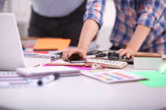 Young business people working at office on new Royalty Free Stock Photos