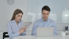 Young Business People Working on Tablet and Laptop stock footage