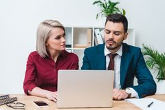 young business people working together and using laptop stock image