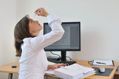 Young business person applying eyes drops Royalty Free Stock Image