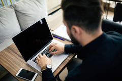 Young business person man working with laptop at workplace royalty free stock photo