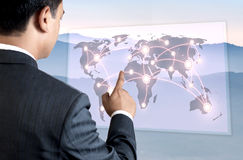 Young Business Person Pointing on the Map. Royalty Free Stock Photo
