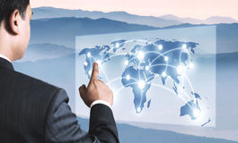 Young Business Person Pointing on the Map. Stock Photos