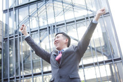 Young Business Person with raised arms screaming.  Stock Photos