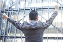 Young Business Person with raised arms screaming.  Royalty Free Stock Photography