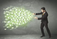 Young business person throwing money concept Stock Image