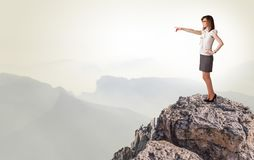 Business person on the top of the rock royalty free stock images