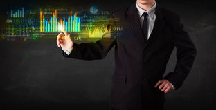 Young business person touching colorful charts and diagrams Stock Images
