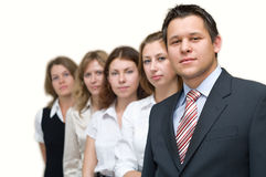 Young business team. Five business persons a team standing in a row. On a white background. One man and four women Royalty Free Stock Images
