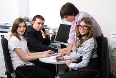 Young business team. Smiling business woman in office at her collegues background Stock Image