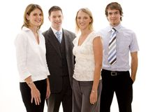 Young Business Team. Four men and women in business wear Stock Images
