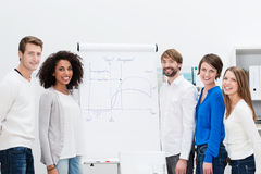 Young business team brainstorming with a flipchart Stock Image