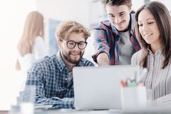 Young business team discussing a project royalty free stock images