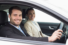 Young business team driving somewhere Stock Images