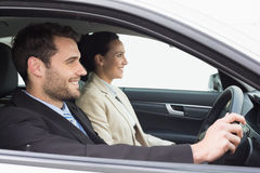 Young business team driving somewhere Royalty Free Stock Images