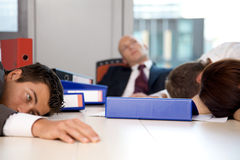 Young business team exchausted and over worked Stock Photos