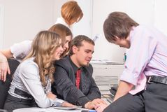 Young business team in front of computer Royalty Free Stock Photo