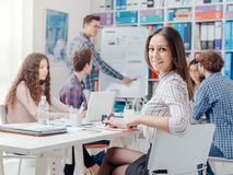 Young business team and girl smiling stock photography