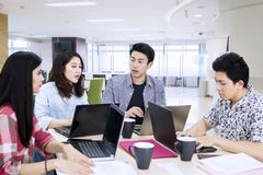 Young business team have a discussion in the office stock photos