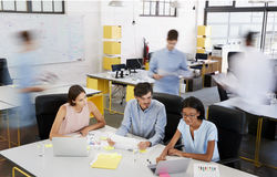Young business team having a meeting in a busy office Royalty Free Stock Photos