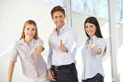 Young business team holding thumbs Royalty Free Stock Photo