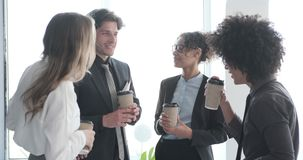Business team interacting while having coffee break in office stock video footage