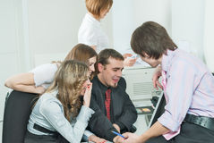 Young business team laugh in front of computer Royalty Free Stock Photo