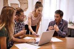 Young business team in lively discussion Stock Photography