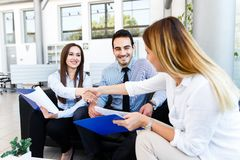 Young business team made great job. Young business team made gread job - success and handshake - deal reached royalty free stock photography