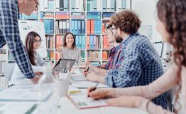 Young business team meeting in the office royalty free stock photos