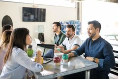 Startup team at office cafeteria stock photography