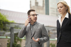 Young business team on phone Royalty Free Stock Photography