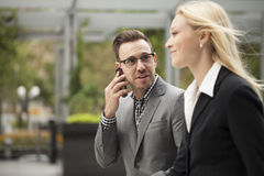Young business team on phone Stock Image